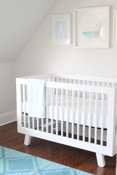 babyletto hudson looking crisp as white linen in this nursery by the picket fence projects