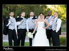 A bride with the groomsmen! Be sure to get this picture for your wedding!   blog.tonyabeaverphotography.com