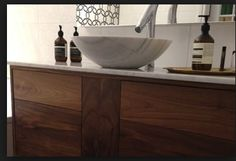 timber vanity with stone top and basin