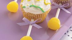 Slices of sweet pear are tucked inside tender cupcakes easily made from white cake mix. Gumdrop lollipop stick handles are a fun addition.