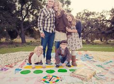Ok...how fun would it be to have everyone playing Twister, and THEN you take the shot??  Haha!  What great smiles you'd get!