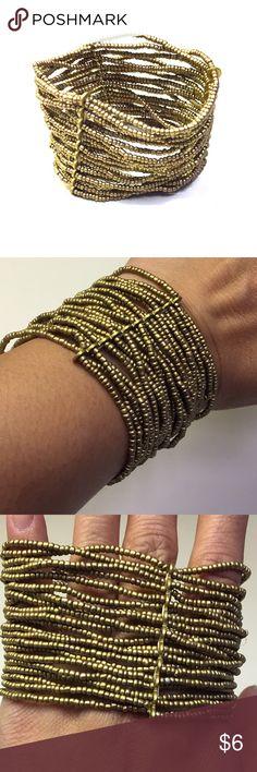 Gold Micro beads on a stretchy bracelet Gold micro beads. Several strands on stretchy cord. Jewelry Bracelets