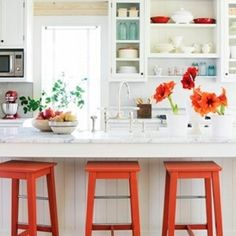 Colorful stools.. What an easy way to brighten the room!