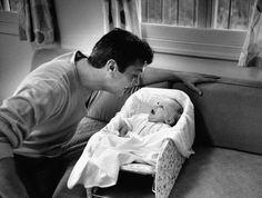 Tony Curtis smiles at his daughter, Jamie Lee, in 1959.