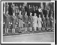 The American Women's Voluntary Services provided support services such as ambulance driving, message delivery, dog-sled teamsters, firefighters, aerial photography, and canteen workers.   Photo: American Women's Voluntary Services members posed on steps, wearing various AWVS uniforms ~