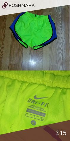 Nike dri-fit running shorts Worn once  Perfect condition Neon yellow, royal blue, and black trim Nike Shorts