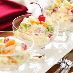 Fruit Ambrosia - sc milk, sour cream, lime j, pineapple, m orange, grapes, coconut, marshmallows, m cherries