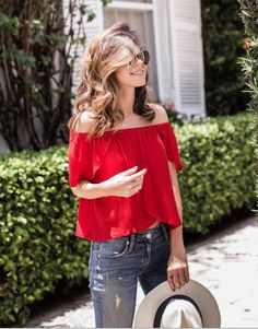 21 Genius Outfit Ideas to Steal This Summer: A Shoppable Guide | @stylebungalow's red off-the-shoulder blouse paired with denim and a black and white fedora