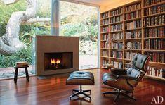 library w fireplace set into glass