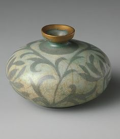 [Goryeo dynasty (918–1392) late 12th century Korean stoneware bottle with reverse-inlaid decoration of peony leaves under celadon glaze. The Metropolitan Museum of Art.]    http://stylecourt.blogspot.com/2012/01/happy-birthday-edith.html