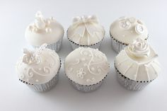 http://www.thefairycakery.com/fairycakery/images/portfolio/fairycup/vintage%20ivory%20cupcakes.jpg