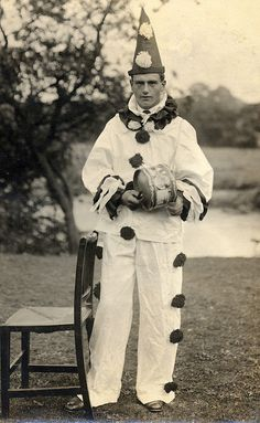 Pierrot with drum...or psycho in a clown costume.