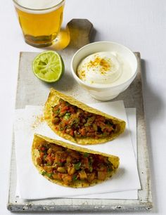 Bean chilli tacos  Who wouldn't love bean chilli tacos that are ready in just 30 minutes? Try this quick veggie midweek meal with tangy sour cream and fresh coriander for a real meat free Monday treat.