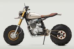 The Classified Moto Honda Big Wheel Monster is the brain child of John Ryland. He is known for building the wild bikes of The Walking Dead. Concept Motorcycles, Custom Motorcycles, Custom Bikes, Cars And Motorcycles, Custom Bobber, Motos Honda, Honda Bikes, Honda Scrambler, Moto Bike