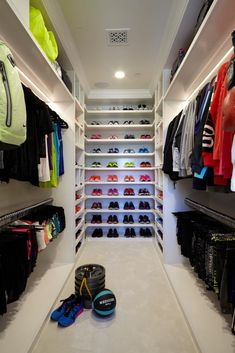 Lisa Adams, owner of LA Closet Design, created her a dream walk-in fitness closet for Khloe Kardashian, star of Keeping Up With the Kardashians. This stunning closet has custom lit hanging rods, a mini fridge and glass display cases.