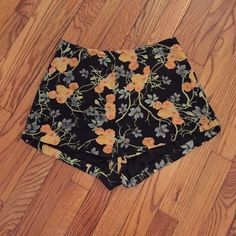Floral shorts High waisted short shorts with a beautiful peach floral print! Zip closure in the back. These shorts look adorable paired with a crop top and tights! Urban Outfitters Shorts