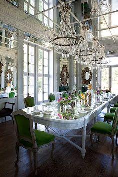 Interesting combo - glam + industrial open ceiling + green velvet chairs