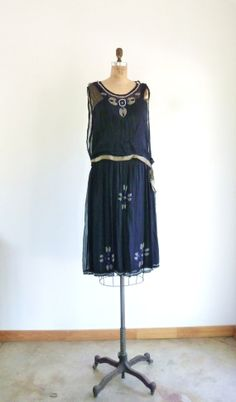 Hey, I found this really awesome Etsy listing at https://www.etsy.com/listing/166228910/midnight-blue-beaded-silk-1920s-dress