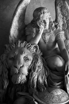 Angel and lion statue at Basilica di Santa Croce di Firenze in Florence, Italy.