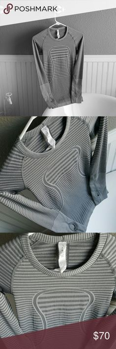 PERFECT Condition Lululemon Top! Selling a PERFECT Condition Lululemon Top! Worn only once. Basically brand new, size tag torn partially but still in tact. Very comfortable, stretchy, size 2. lululemon athletica Tops
