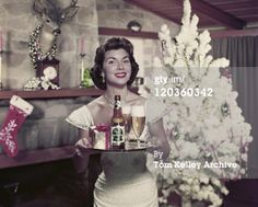 Unknown : Young woman holding beer and gift in tray, smiling, portrait