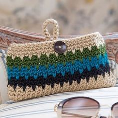 Crochet this case to keep glasses safe wherever you put them! Click on the link in our profile to download the free crochet pattern and buy the yarn, or search for LW5021 Dynamite Eyeglass Case on RedHeart.com. Designed by @salenabacacrochet. #crochet #crochetersofinstagram #freepattern #redheartyarns