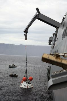 U.S. Navy Fishes NASA's Orion Spaceship Out of the Pacific after tests.