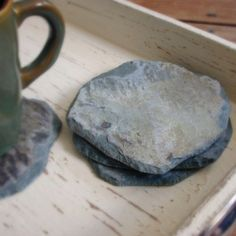 Slate coasters, recycled from slate roofs of historic buildings...on etsy