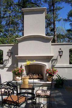 limestone outdoor fireplace WITH A HERRINGBONE BRICK FIREBOX