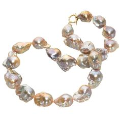 Russell Trusso Lustrous Pink Purple Blue Baroque Pearl Necklace   From a unique collection of vintage more necklaces at https://www.1stdibs.com/jewelry/necklaces/more-necklaces/