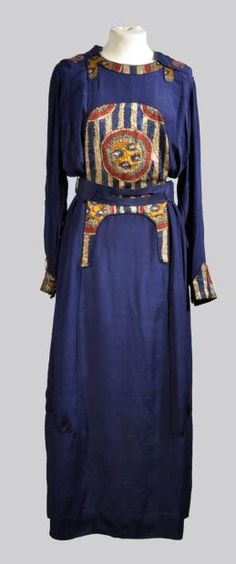 "1910 Paul Poiret silk dress with dark blue ""orientalism"" appliques and a drawstring waist."