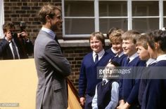 News Photo : Prince Edward chats to school children after...