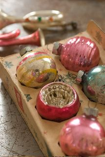 Pink and Christmas have always gone well together.If you watch Rudolph the Red nose Reindeer movie,there is alot of pink,Clarice's bow the packages etc.....    Decorating the tree would be so fun with Clarice from Build A Bear  with these old timey Christmas Ornaments