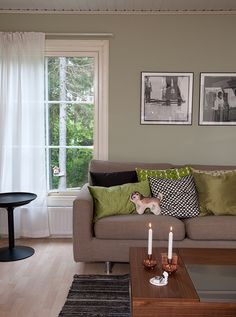 Cosy livingroom in the countryhouse. Different browns and copper in combination with black details brings out the dim green wall paint Alcro Salvia.