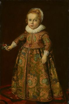 Attributed to Flemish School, c. 1620. The patterned silk...WOW! A full-length portrait of a red-haired young boy, facing the spectator, standing on a patterned carpet holding a posy of flowers in his right hand; he wears a green jacket with an orange floral pattern fastened by red buttons and a bow