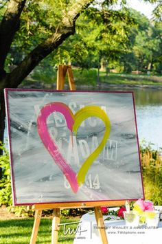 Unity Heart! Bride and groom each paint a side of the heart with their favorite colors!