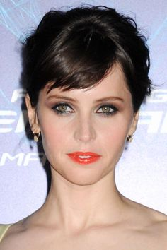 <p><strong>Seen On</strong>: Felicity Jones</p> <p><strong>How-To</strong>: Hairstylist Tommy Buckett started with Jones' hair down, but wanted to give her whole look a more youthful vibe, so he misted on a ton of beach spray and then started twisting and pinning strands into an untidy updo. As for the lips, makeup artist Hung Vanngo mellowed out an orange-based red with a swipe of a shiny pinkish tone.</p> <p><strong>Editor's Picks</strong>: <strong>Garnier Fructis</strong> Style ...