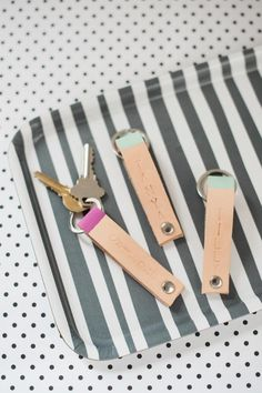 DIY: Personalized Leather Key Chain | HGTV >> http://www.hgtv.com/design/make-and-celebrate/handmade/how-to-make-a-personalized-leather-key-ring?soc=pinterest