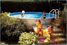 Above ground pool with deck and landscaping--I'd love an in ground-- but this is cheaper way to go!!: