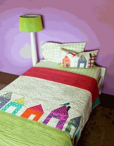 Wonky little houses quilt.  I have this pattern!  I just need to take some time and make it!!