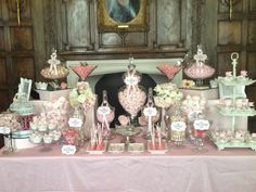 Vintage Candy Buffet- a mush mash of suitcases, glass jars, cameras, and petestals