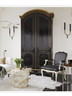 Handsome Armoire is actually a Built In for a Flat Screen TV. Fantastic idea for a small space.