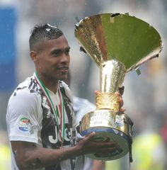 Alex Sandro of Juventus FC celebrates with the trophy after winning the Serie A Championship at the end of the serie A match between Juventus and Hellas Verona FC at Allianz Stadium on May 2018 in Turin, Italy. 2012 Summer Olympics, Man Of The Match, Fc Porto, Body Figure, Juventus Fc, Uefa Champions League, Fantasy Football, Sandro, Ronaldo