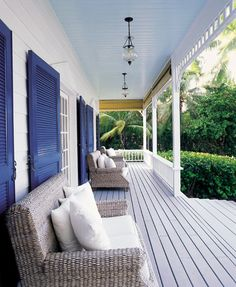 the moorings village, islamorada.  white with blue shutters. love the seagrass seating with white pillows.