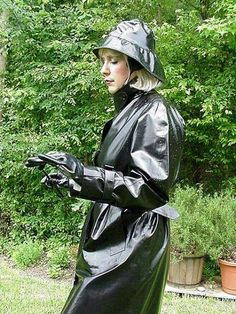 Christine the Rainwearist in her Shiny Black Rubber Mackintosh.