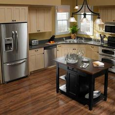 Stainless Steel Appliances off white cabinets wood floor & lt yellow walls ~ not that color counter though....