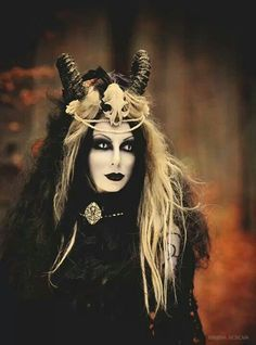 (photo, demon, with horns; costume, goth, cat eye contact lenses)