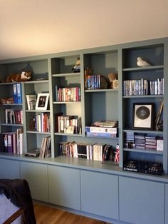 Smart stylish contemporary bookcase providing plenty of library shelving and hidden cupboard storage Built In Shelves Living Room, Home Office Shelves, Living Room Bookcase, Living Room Wall Units, Living Room Update, Living Room Storage, Built In Bookcase, Home Living Room, Living Room Furniture