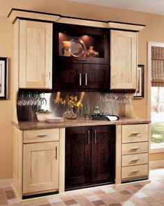 This refreshment center featuring Wellborn Cabinet, Inc. Premier Series could get any party started! Allow us to get your home entertainment-ready 🍸