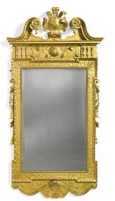 A George II gilt-gesso pier mirror Circa 1740 The reverse with a paper label inscribed MARIE LADY LEIGH. Over-gilt. height 6 ft. 3 in.; widtgh 37 in.